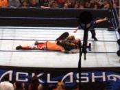 The Undertaker applies the Gogoplata to Edge.