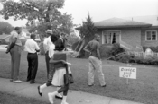 Group of African Americans viewing the bomb-damaged home of Arthur Shores, NAACP attorney, Birmingham, Alabama