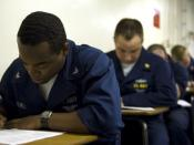 English: CORAL SEA (July 1, 2007) - Personnel Specialist 3rd Class Darryl Mitchell, from Dallas, takes a College Level Examination Program (CLEP) test on USS Kitty Hawk (CV 63). Sailors earn college credits for passing the exams, which are given on numero