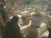 Khaled Mohamed Saeed's mother visiting his grave