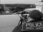Secret Service agents positioned atop the roof of the White House.