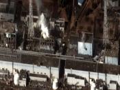 English: The after the Polski: Zniszczenia na terenie elektrowni wywołane trzęsieniem ziemi u wybrzeży Honsiu, tsunami i awarią – zdjęcie satelitarne reaktorów nr 1, 2, 3 i 4 z 16 marca 2011