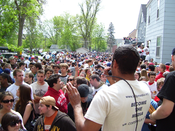 A slam poem is recited by Toussaint Morrison of the Minneapolis band The Blend for a crowd at the 2007 Mifflin Street Block Party.