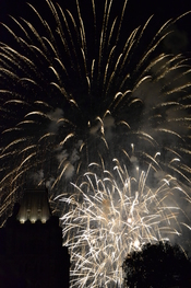 English: White fireworks go off over parliament hill,
