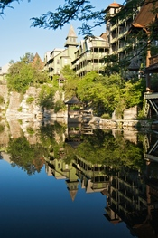 View of gazebo and guest rooms from the location where guests are encouraged to feed trouts with food pellets, at Mohonk Mountain House
