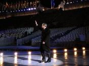 English: President George W. Bush waves to the crowd as he walks across the ice during the opening ceremonies for the 2002 Winter Olympic Games in Salt Lake City, Utah
