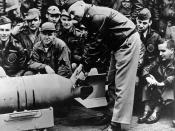 English: LtCol James H. Doolittle, USAAF Doolittle Raid on Japan, April 1942 Lieutenant Colonel James H. Doolittle, USAAF (front), leader of the raiding force, wires a Japanese medal to a 500-pound bomb, during ceremonies on the flight deck of USS Hornet