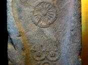 Footprint of the Buddha. 1st century, Gandhara, with depictions of the triratna and the Dharmacakra.