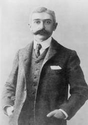 Baron Pierre de Coubertin, half-length portrait, standing, facing front