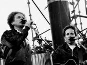 English: Singer-Songwriter duo Simon & Garfunkel performing outside at a concert in Dublin