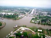 English: Aerial view of the intersection of Bayou Lafourche and the Gulf Intracoastal Waterway at Larose, Louisiana, USA. The waterway runs left–right across the photograph and the bayou runs off into the distance at the top. The U.S. Army Corps of Engine