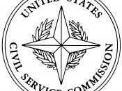 Illustration of the seal of the United States Civil Service Commission from Executive Order 11096, which defined the seal. The design is described there as: On a white background a four-pointed ridged gold star over a palm wreath in green with a gold tie,
