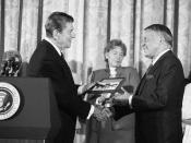 Sinatra is awarded the Presidential Medal of Freedom by President Ronald Reagan.
