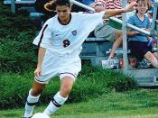 Us womans soccer legend Mia Hamm takes corner kick.