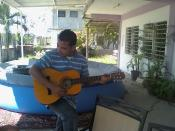 English: This is Rogelio Rivas trying to learn his guitar lessons.