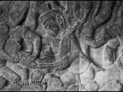 Bas relief of a massage abortion. The operator is a demon rather than a traditional birth attendant. The pregnant woman's abdomen is darkened from being touched by pilgrims to Angkor Wat. The bas relief dates from about A.D. 1150.