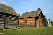 Bennett Place, a carefully reconstructed historic farm in Durham, North Carolina, the site of the largest surrender of Confederate soldiers during the American Civil War on April 26, 1865. Showing, from left to right, the kitchen, the farmhouse, and the m