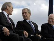 Secretary of Defense Donald Rumsfeld shares a laugh with President George W. Bush and Vice President Dick Cheney during his farewell parade at the Pentagon.