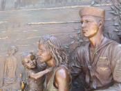 Sculpture of a sailor and his family, gazing eastward, over Lake Michigan