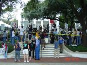 Protesters gather at the front gate of the Texas governor's mansion during the 6th Annual March to Stop Executions