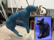 The foreground shows a cat undergoing Summum's modern mummification process. The cat's wrappings are receiving coats of polyurethane. In the background, another cat is being fitted into a sculpted bronze Mummiform®. The inset shows a finished cat mumm