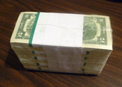 1000 United States two-dollar bills in shrink wrap.