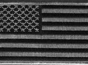 English: A subdued-color version of the flag of the United States, in the form of a patch intended to blend with urban camouflage.