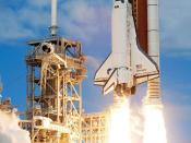 The Space Shuttle Discovery and its seven-member STS-120 crew head toward Earth-orbit and a scheduled link-up with the International Space Station. Liftoff from Kennedy Space Center's launch pad 39A occurred at 11:38:19 a.m. (EDT). Onboard are astronauts