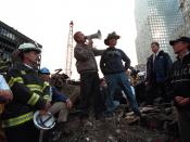Bush, standing with firefighter Bob Beckwith, addresses rescue workers at Ground Zero in New York, September 14, 2001.