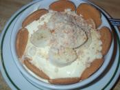Banana pudding served in a bowl with vanilla wafers