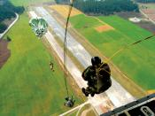 Military static line jump, from the rear of a C-130 Hercules