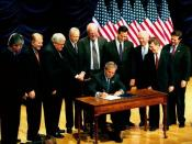 George W. Bush signing the Partial-Birth Abortion Ban Act of 2003, surrounded by members of Congress