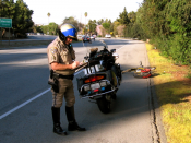 English: A motorcycle patrol officer on the San Tomas Expressway near Benton Avenue in , USA.