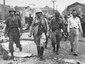 English: World War II. Ernest Stanley (white shirt) accompanies Japanese soldiers out of Santo Tomas Internment Camp, Manila, Feb 1945