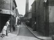 A cobbled slum street in a Deptford, London, Circa 1900