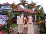 English: Wedding photograph (Net [groom], Nusscharin of the bride and Jinda [bride]). Na Khun Yai, Thailand.