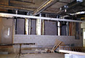Dupont Canada building in Mississauga, Ontario, Canada, HVAC shaft wall construction made of concrete block, 2 hour fire-resistance rating. The ducts are made of sheet metal and insulated with fibreglass insulation.