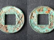 English: The front and reverse sides of a metal coin, 25.5 mm in diameter, issued during the reign of Emperor Wu (r. 141–87 BCE) of the early Han Dynasty of China.