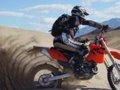 Dumont Dunes, California. Rider (author) is on 2004 KTM EX/C 525 dirt-bike outfitted with paddle tire. Dumont is 30 miles north of Baker on Highway 127 and features the highest dunes in California. It is also one of the few sand dune areas that exhibit an