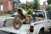 English: Dirt bike fixed to a truck bed on Franklin Street in Chapel Hill, North Carolina.
