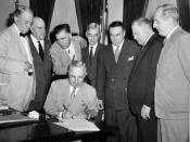 President Harry S Truman signs the Atomic Energy Act of 1946 establishing the U.S. Atomic Energy Commission. Behind the President, left to right: Senators Tom Connally, Eugene D. Millikin, Edwin C. Johnson, Thomas C. Hart, Brien McMahon, Warren R. Austin,