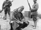 A captured Japanese soldier crouches before his Chinese captors at Changde in the Hunan Province.1943 Battle of Changde. November 2, 1943 - December 20, 1943