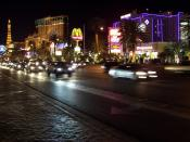 Las Vegas Strip at night with the Aladdin (now Planet Hollywood)