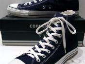 A classic Black pair of Converse All-Stars resting on the Black & White Ed. Shoebox (1998-2002)