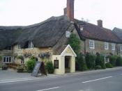 English: The Crown or The Pure Drop. Thomas Hardy imagined Marnhull to be the fictional birthplace of Tess (Tess of the d'Urbervilles) and this pub is called Pure Drop Inn where her father celebrated after hearing he was the descendant of a noble family.