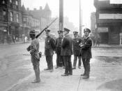 English: five policemen and one soldier with a rifle standing on a street corner during a race riot in the Douglas community area of Chicago, Illinois.