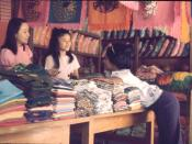 English: negotiating with fabric store owners in Chiang Mai, thailand. November 1973