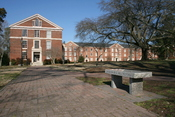 English: The campus of the Southeastern Baptist Theological Seminary in Wake Forest, North Carolina, showing Botswick Hall (left) and Goldston Hall (right) in the background and a bench dedicated to G. Paul Fletcher in the foreground.