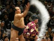 English: Sumo wrestler Kitazakura throws salt before a bout, Tokyo, October 2007 Category:Japanese sumo wrestlers