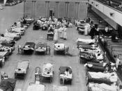 1918 flu epidemic: the Oakland Municipal Auditorium in use as a temporary hospital. The photograph depicts volunteer nurses from the American Red Cross tending influenza sufferers in the Oakland Auditorium, Oakland, California, during the influenza pandem
